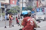 Children photographed begging at a main junction in central Mandalay. (PHOTO: DVB)