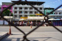 An immigration queue on the Thai side of the Thai-Burma border. (Photo: Wenying Seah / DVB)