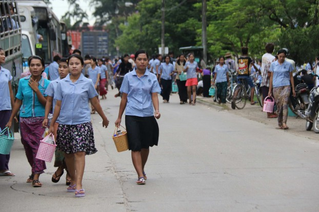 A group of factory workers in an industrial zone in Rangoon's Mingaladon Township. (Wai Yan / Myanmar Now)