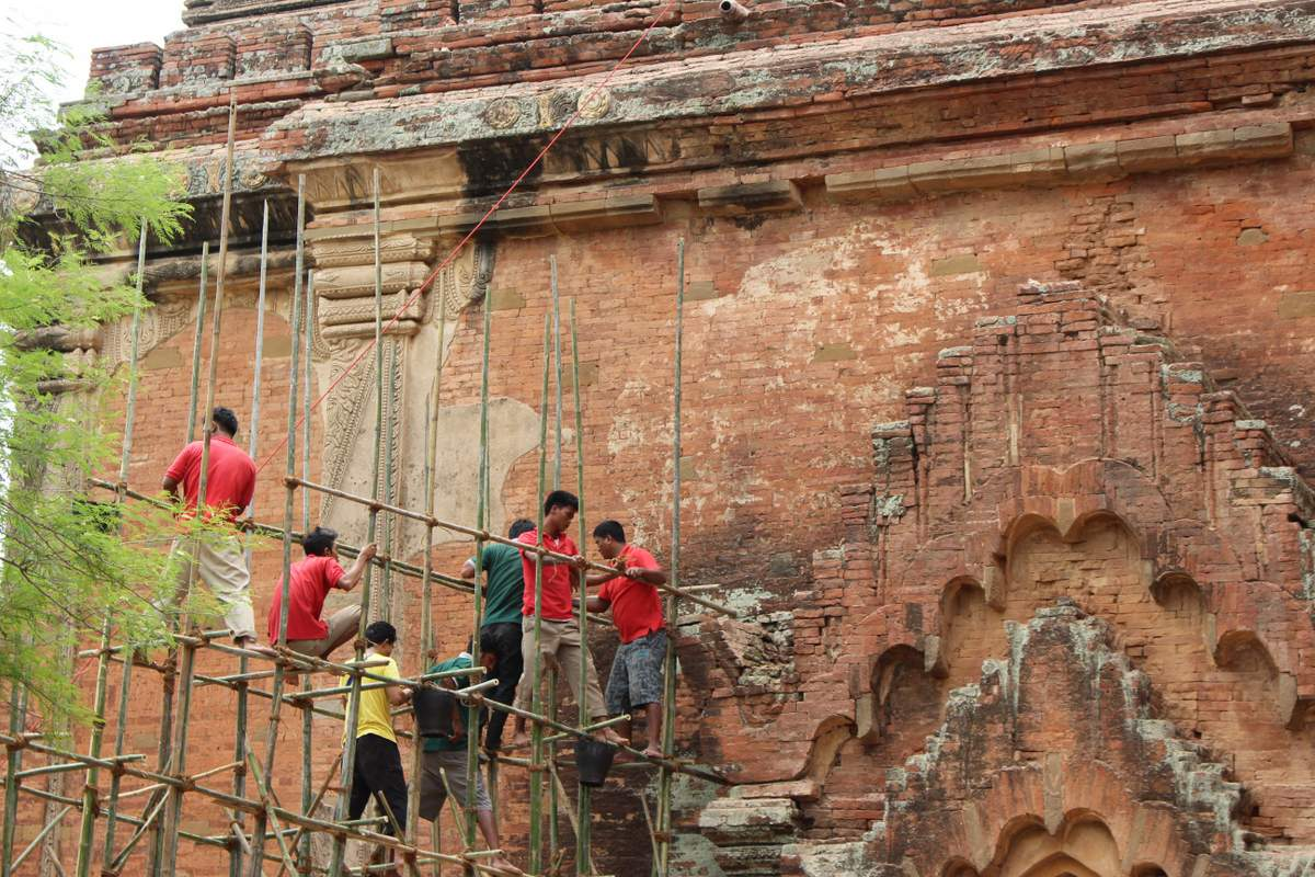 Men working to install bamboo scaffolding around the Sulamani Temple in Bagan. (Photo: Libby Hogan / DVB)