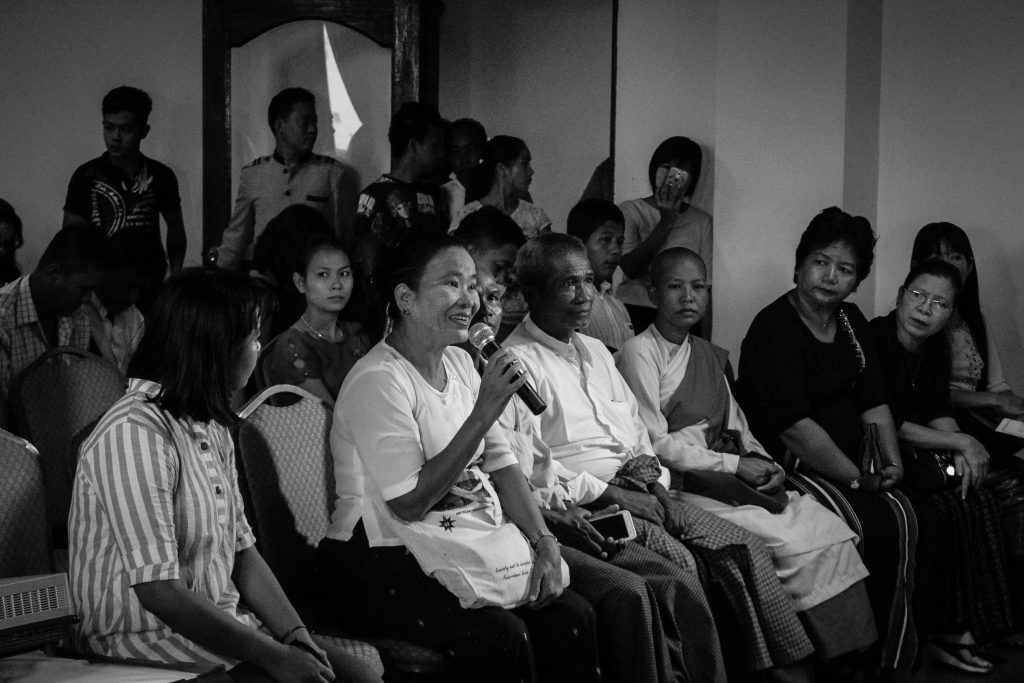 A lady asks a question about domestic violence at a joint conference held by Akhaya Women and Legal Clinic Myanmar in Rangoon on Saturday. (Photo: Libby Hogan / DVB).