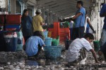 File photo of a group of Burmese migrants working in a fishing port in the town of Ranong in southern Thailand. (Photo: Myanmar Now)
