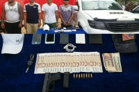 Lashio police photo of the four detained youths, their SUV and items found in their possession.