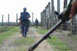 Burmese border police patrol a barbed-wire fence separating Burma and Bangladesh. (Photo: DVB)