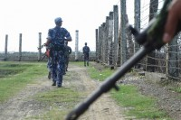 Burmese border police patrol a barbed-wire fence separating Burma and Bangladesh. (Photo: DVB)