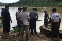 Police in Indaw Township, Sagaing Division, recover the body of a colleague who drowned while in pursuit of a barge believed to be carrying illegally logged timber. (Photo: DVB)