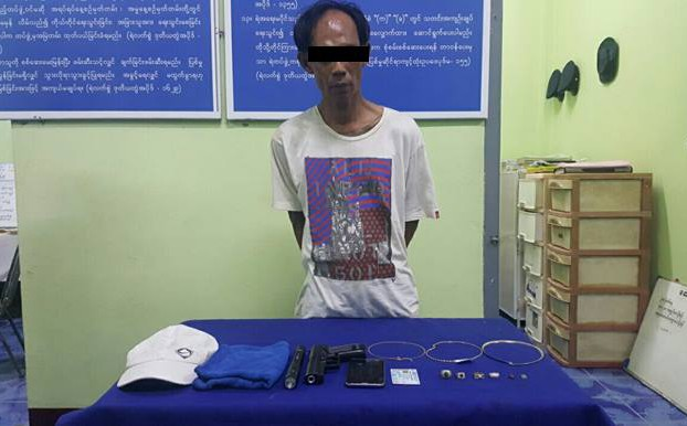 """Suspected thief """"Mr. Rachan"""" of Thailand poses for a police photo with goods he allegedly stole from a jewellery store in Tachilek. (Photo: Myanmar Police Force)"""