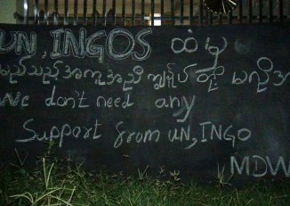 A sign outside a monastery sheltering ethnic Arakanese displaced by recent violence in Arakan State's Maungdaw Township sends an unwelcoming message to international aid agencies. (Photo: DVB)