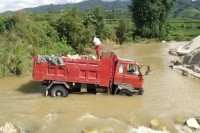 A truck loaded with sandstone crosses the Nam Siri Creek in Shan State's Muse Township. (Photo: DVB)