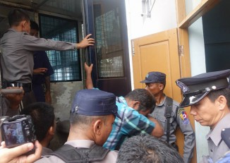 The defendants in the Ava Tailors abuse case are escorted into the Western Rangoon District Court on 13 October 2016. (Photo: DVB)