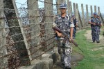 Burmese border police patrol the fence separating Burma and Bangladesh on 18 October 2016. (Photo: DVB)