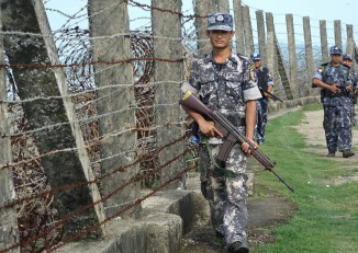 Burmese border police patrol the fence separating Burma and Bangladesh on 18 October 2016. (Photo: DVB)