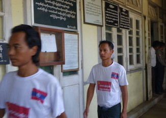 Two of the Sagaing marchers appear outside a courthouse in Tatkon Township on 24 October 2016. (Photo: DVB)