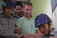 "Dutch tourist Klaas Haijtema is escorted from a Mandalay  court on 6 October 2016 after being sentenced to three months in prison for ""disturbing a religious assembly"". (Photo: DVB)"