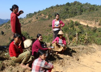 Women in Shan State take a rest on the side of a road. Reforms in Burma continue to leave many women behind.  (Photo: Libby Hogan / DVB)