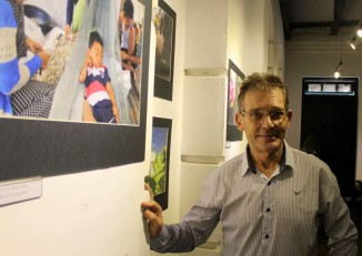 "Photographer John Hulme at the opening of his exhibition ""Beyond Tolerance: Living Together with Migrants"" at Rangoon's Deitta Gallery on 28 October 2016. (Photo: Libby Hogan / DVB)"