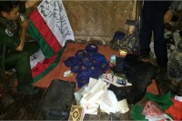 Burmese soldiers display flags and other items allegedly linked to the Rohingya Solidarity Organisation, a militant group that has been largely inactive for more than a decade. (Photo: Myawady)