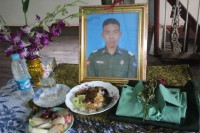 Family photos on the altar commemorate the life of DSA cadet Aung Nyi Nyi Zaw, who died aged 18 last week. (PHOTO: Libby Hogan/ DVB)