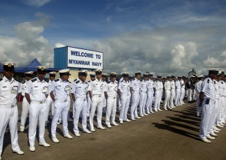 Burma navy officers line up to welcome their Chinese counterparts on 1 October 2016. (Photo: DVB)