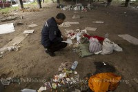 An officer from Thailand's Crime Suppression Division collects evidence at the crime scene under the Lat Phrao intersection flyover in Bangkok on Sunday. (Photo: Bangkok Post)