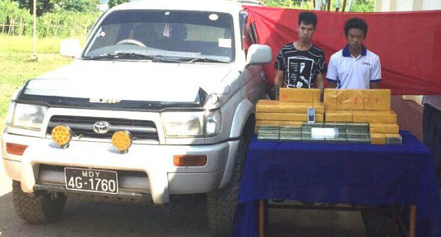 A police photo of the two men accused of transporting 200 blocks of heroin in Loilem District on 20 October 2016.