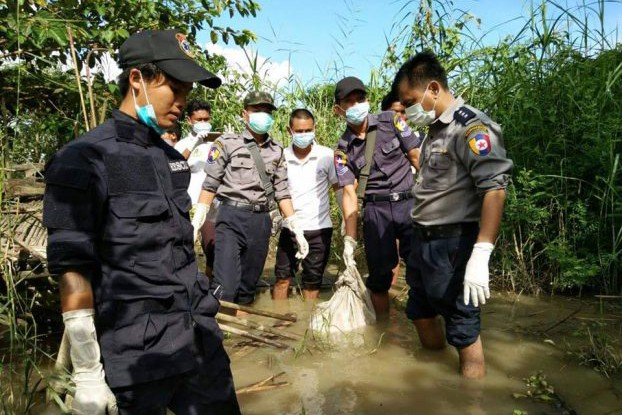 Twante police recover a child's body from the river. (PHOTO: DVB)