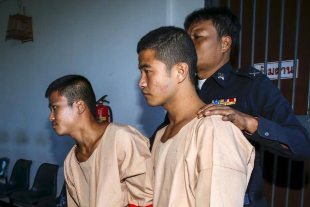 FILE PHOTO: Zaw Linn and Win Zaw Tun are escorted by a Thai security office. (Photo: MWRN)