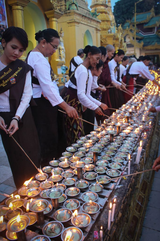 Rows of candles being lit around Shwedagon Pagoda. (Photo: Libby Hogan / DVB)