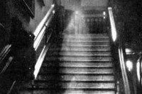 Brown Lady of Raynham Hall, a claimed ghost photograph by Captain Hubert C. Provand. First published in Country Life magazine, 1936.