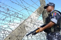 A member of Burma's border police force stands guard near the border of Bangladesh. (Photo: DVB)