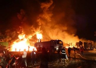 Firefighters put out a blaze that destroyed a warehouse owned by a jade-mining company in Hpakant on 2 November 2016. (Photo: Myawady News)