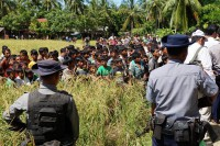 Burmese police escort foreign diplomats during a tour of northern Arakan State on 2 November 2016. (Photo: DVB)