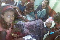 A man receives medical attention after allegedly being abducted by attackers who burned down his home in Maungdaw Township on Monday. (Photo: Myawady News)