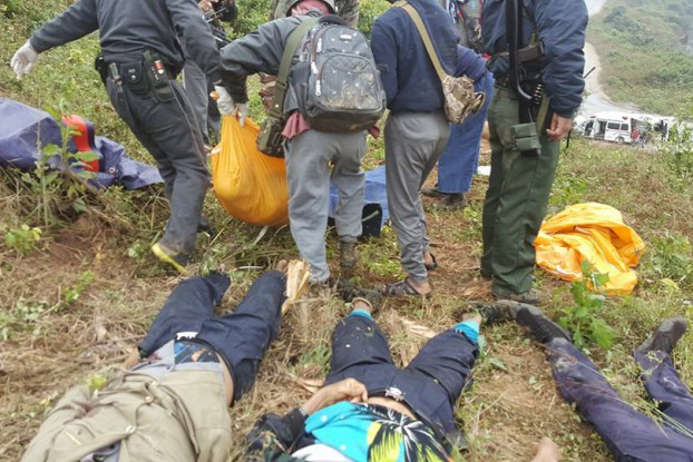 The bodies of three police officers lay on the ground as another body is carried away, following an attack by ethnic rebels on a checkpoint in Muse on 20 November 2016. (PHOTO : DVB)