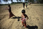 File photo of a boy carrying a ration of meat distributed as aid in Arakan State. (Photo: Reuters)