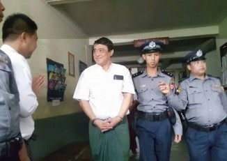 Eleven Media Group CEO Than Htut Aung, pictured in handcuffs at Tamwe police station on 11 November 2016. (PHOTO: DVB)
