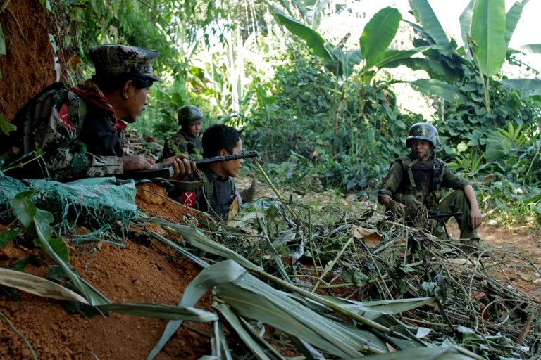 2013 file photo of rebel Kachin Independence Army (KIA) 3rd Brigade soldiers (PHOTO: AFP)