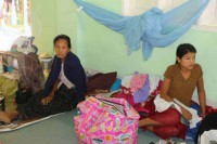 Displaced women from Maungdaw sit in the Alodawpyae Monastery in Buthidaung. (PHOTO:DVB)