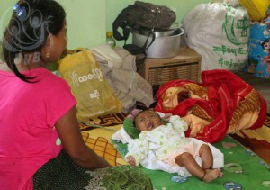 Mother tends to her baby at the monastery in Buthidaung. (PHOTO: DVB)