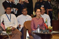 State Counsellor Aung San Suu Kyi sits beside members of the Malaysia delegation at a meeting of ASEAN foreign ministers in Rangoon on Monday. (Photo: DVB)