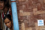 Ethnic Kachin refugees look out from their shelter at Jam Mai Kaung IDP camp in Myitkyina, Kachin State, on 30 July 2015. (Photo: Reuters)