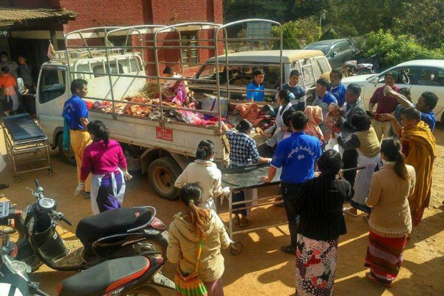 Civilians are seen loading a truck to flee fighting in Kyaukme township, Shan State. (Photo: Tin Maung Thein)
