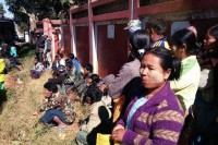 Farmers facing trial on criminal trespass charges wait outside the court in Taunggyi township, Shan State, on Thursday. (Photo: DVB)