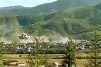 """This picture in the Myawady News on 2 December 2016 was captioned: """"'Tatmadaw-men courageously battle in Mongko"""".  It appears to show either an artillery strike or a bombing run on rebel positions, but this cannot be confirmed."""