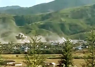 "This picture in the Myawady News on 2 December 2016 was captioned: ""'Tatmadaw-men courageously battle in Mongko"".  It appears to show either an artillery strike or a bombing run on rebel positions, but this cannot be confirmed."