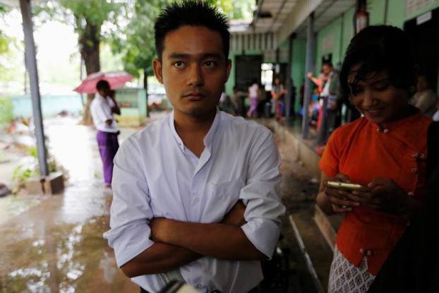 Poet Maung Saungkha, one of the Telecommunications Law's best-known victims, is pictured after a court sentenced him to six months in jail for defaming former President Thein Sein on 24 May 2016. (Photo: Reuters)