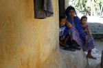 A Rohingya woman and her children look on as they sit in front of their house at Kutupalang refugee camp in Cox's Bazar, Bangladesh, on 21 November 2016. (Photo: Reuters)