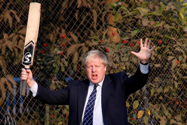 British Foreign Secretary Boris Johnson gestures as he plays during a visit to a cricket academy in Kolkata, India, on 19 January 19. (Photo: Reuters)
