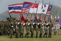 Thai soldiers participate in a parade as they carry various country flags during the opening ceremony for the Cobra Gold military exercise at a Royal Thai Marine corps headquarters in Chonburi, east of Bangkok, on 9 February 2016. (Photo: Reuters)