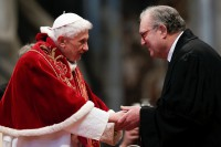 Then-Pope Benedict XVI, left, is greeted by Matthew Festing, Grand Master of the Sovereign Order of Malta, during a mass for the 900th anniversary of the Order of the Knights of Malta at St. Peter's Basilica at the Vatican on 9 February 2013. (Photo: Reuters)